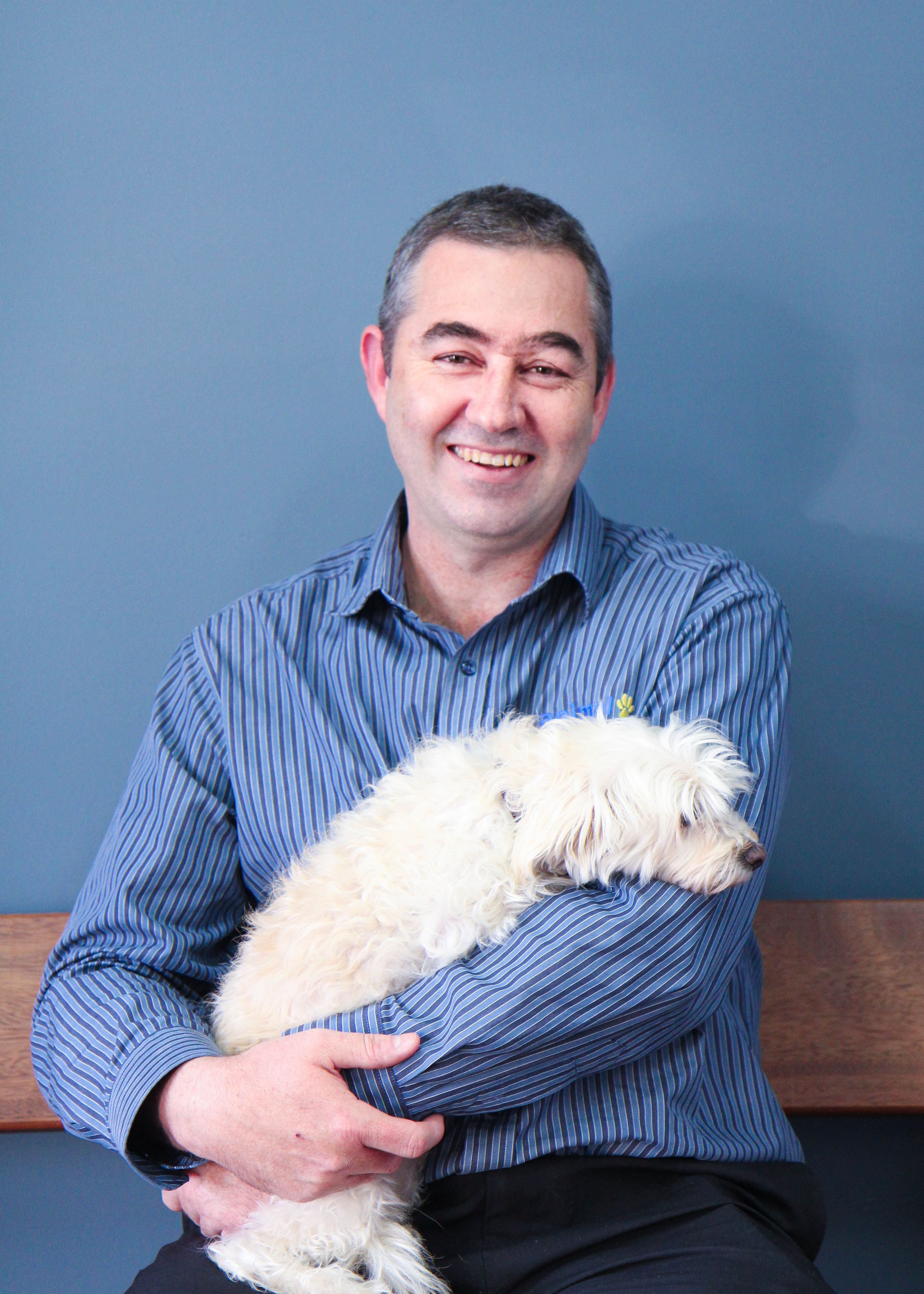 Animal Tracks Vet Todd with his two maltese cross dogs Lily and James