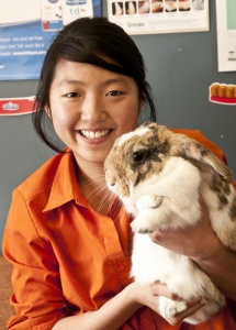 Animal Tracks Vet Nurse Cassey with a fluffy bunny rabbit